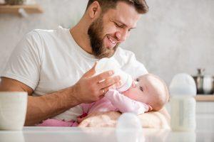 supportive partner feeding baby